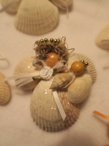 Seashell angels. This one holds a baby.