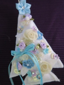 White trees with lots of embellishments.