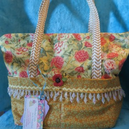 Insulated Lunch Bag in gold and coral floral with zippered closure $24.99